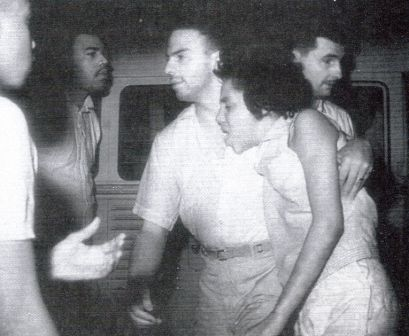 Andrew Young helping a protestor who was hurt by the mob