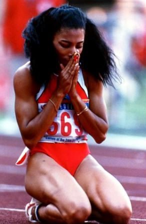 Florence Griffith Joyner winning the gold medal in the 200 meters in Seoul Korea