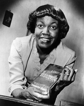"Gwendolyn Brooks with her Pulitzer prize winning book ""A Street in Bronzeville"""